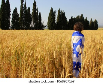 child wrapped in the flag of Israel