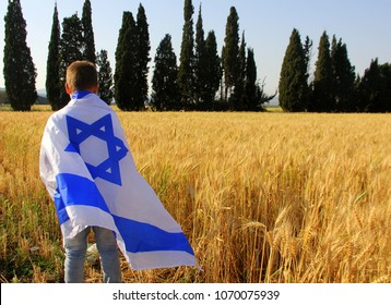 child is wrapped up in the flag of Israel