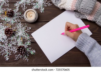 Child writes letter to Santa Claus.A letter of congratulation with Christmas. Wish list. Christmas background.