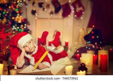 Child Writing Christmas Letter, Happy Kid Write Wish List to Santa in Decorated Xmas Home Room