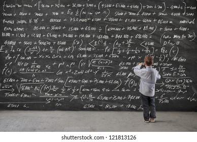 Child writing on a blackboard