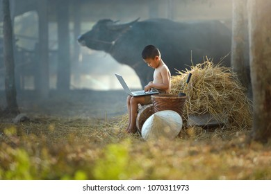 Childen using notebook on the field,thai traditional culture,Thailand