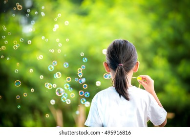 Childern Playing Bubble In The Park