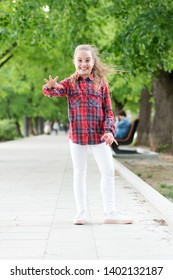 Childhood activities that will never grow old. Happy little child wearing casual plaid design for playing outdoor. Childhood activity on summer day. Happy childhood. Childhood concept.