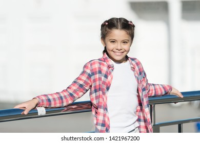Childhood activities that will never get dull. Happy little child smiling in casual plaid style for playing outdoor. Childhood activity on summer day. Happy childhood. Childhood concept.