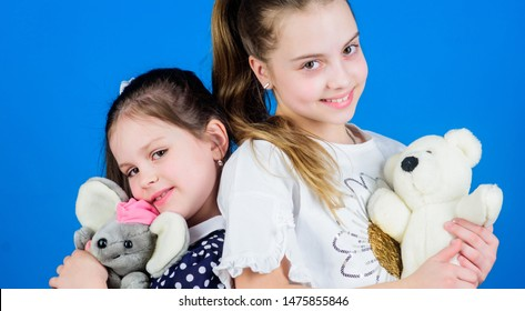 Childhood concept. Kids adorable cute girls play with soft toys. Happy childhood. Child care. Excellence in early childhood education. Sisters or best friends play with toys. Sweet childhood.