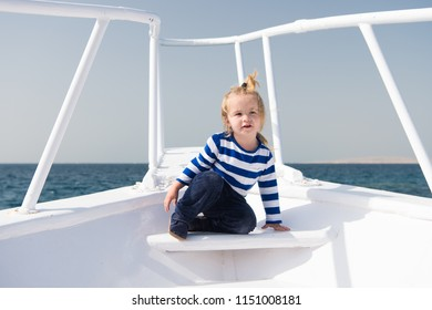 Childhood concept. Little child enjoy sea travel on ship, childhood. Joys of childhood. Childhood experience. Summer vacation and adventure.