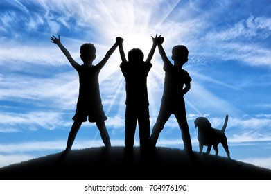 Childhood concept. Silhouette of three happy children and dogs