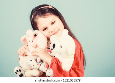 Childhood concept. Small girl smiling face with favorite toys. Happy childhood. Little girl play with soft toy teddy bear. Sweet childhood. Collecting toys hobby. Cherishing memories of childhood.