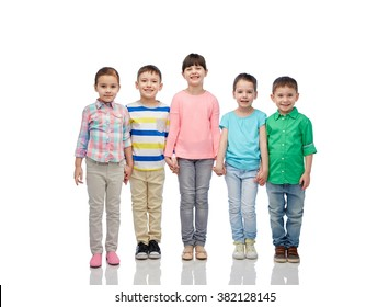 childhood, fashion, friendship and people concept - group of happy smiling little children holding hands