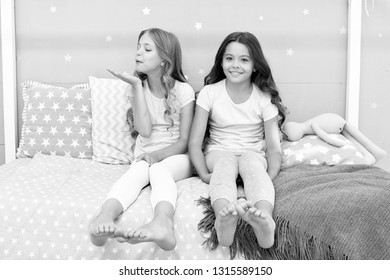 Childhood friendship concept. Girls best friends sleepover domestic party. Girlish leisure. Sleepover time for fun gossip story. Best friends forever. Soulmates girls having fun bedroom interior.