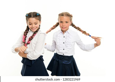 Childhood happiness. Friendship and sisterhood. small kid fashion. childrens day. Back to school. small girl children with perfect hair. Happy little sisters. Beauty and fashion. At the school break.