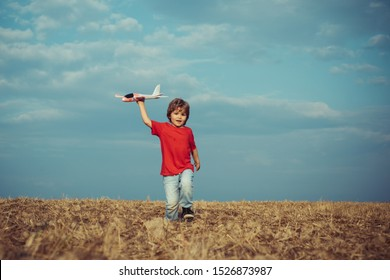 Childhood memories. Active leisure with kids. Kid pilot having fun on meadow. Summer leisure. Cherishing memories of childhood. The concept of child kindness and childhood