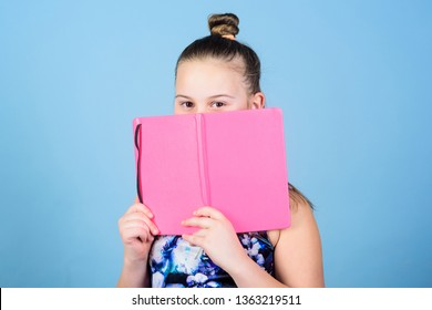 Childhood memories. Diary for girls concept. Note secrets down in cute girly diary journal. Keeping secrets here. Keeping her secrets in diary. Child cute girl hold notepad or diary blue background.