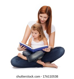 childhood, parenting and relationship concept - happy mother with adorable little girl reading book