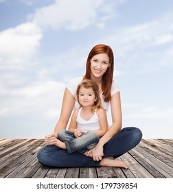 childhood, parenting and relationship concept - happy mother with adorable little girl