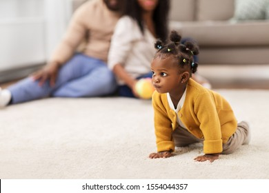 childhood and people concept - african american baby crawling on floor at home