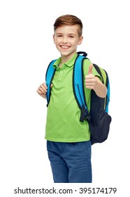 childhood, school, education and people concept - happy smiling student boy with school bag