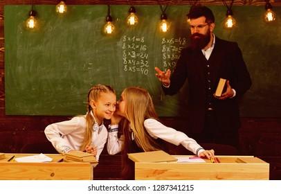 childhood in school. childhood of little girls in school. spend childhood in school. childhood in school for two pertty friends. happy children