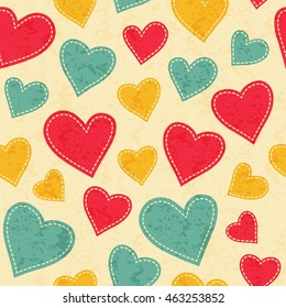 Childish seamless pattern with red, yellow and blue hearts. Hand-sewn style elements with white seams. Bright and happy color palette.