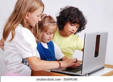 Children activities on laptop put on desk, isolated