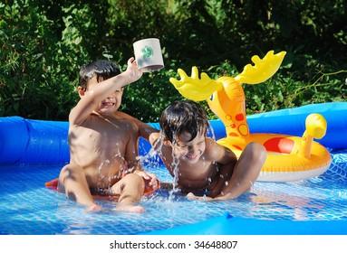 Children activities on swimming pool in summer