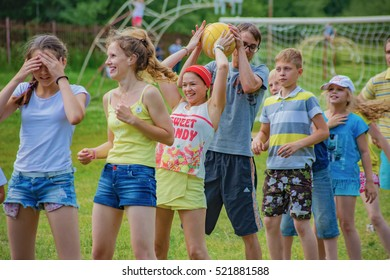 "Children and adults pass the ball. Children's camp ""Berezka"".Editorial. Russia. Yaroslavl region 02.07.2016"