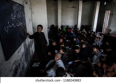 Children of Afghan refugees attend a class in their school at an Afghan refugee camp in Lahore, Pakistan, October 23,2013