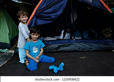 Children among tents on Aug. 3, 2015 at Pedion tou Areos park where some 1500 migrants and refugees live in a makeshift camps in Athens, Greece