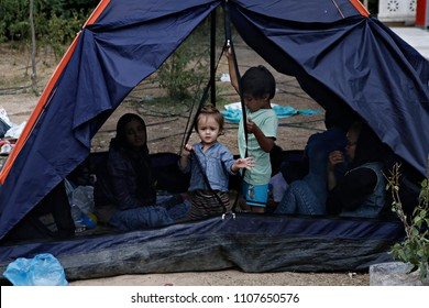 Children among tents on Aug. 10, 2015 at Pedion tou Areos park where some 1500 migrants and refugees live in a makeshift camps in Athens, Greece