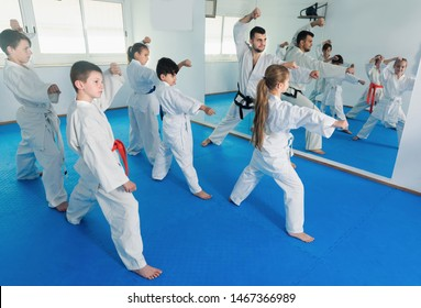 Children attempting to coach and trying a new moves during karate class