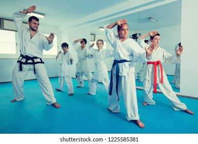 Children attempting to master and trying a new moves during karate class