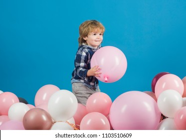 Children background. Happy child on a blue background. Smile on the face of a little boy. Cute kid. Children's advertising. Handsome happy toddler