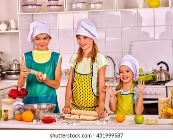 Children bake cookies at kitchen. Children cookies bake something from dough on home kitchen.