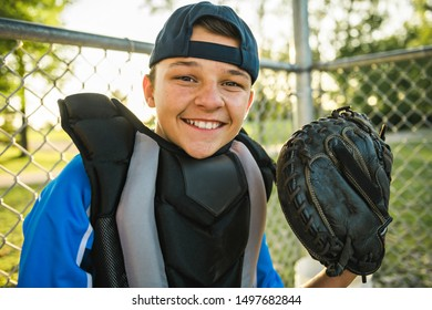 A children baseball catcher players standing on the playground