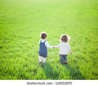 Children in beautiful spring green field