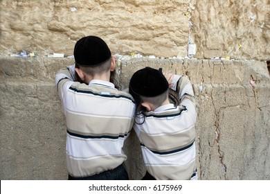 Children being prayed in western wall.
