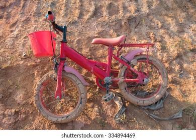 Children bicycle muddy