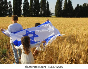 children with the big flag of Israel