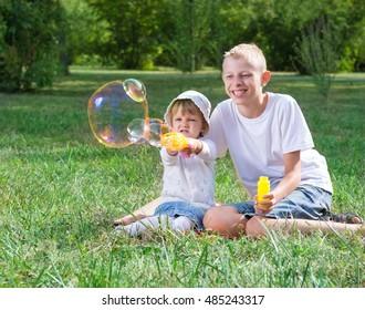 Children blow bubbles in the park