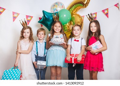 Children blowing birthday candles. Children birthday party