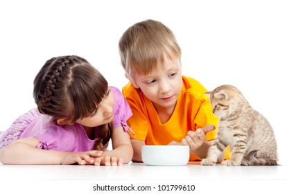 children boy and girl feeding kitten