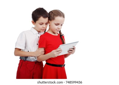 Children a boy and a girl looking at a tablet on white background isolated