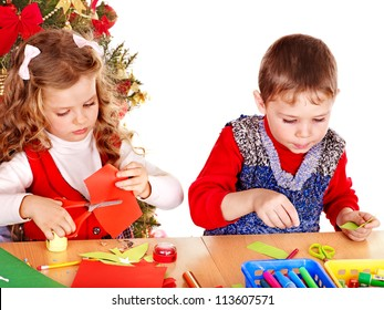 Children boy and girl making decoration card for Christmas.