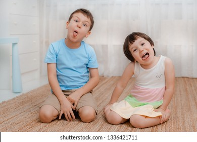 Children, boy girl, naughty floor room They grimace laugh. amusing. Kids bullies Naughty jokers children's fun Restless Child psychology friendship parenting baby 3 years 6 years siblings