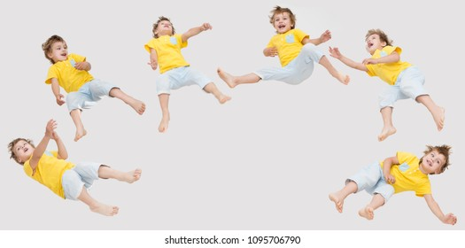 a lot of children boy  jumping on a gray background