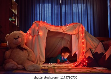 children boy playing in tent