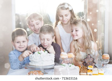 children - boys and girls eating cakes - party