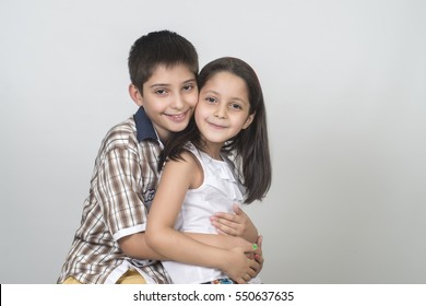 children, brother and sister hugging each other