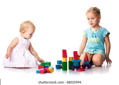 Children building a castle with cubes isolated on white